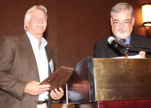 New TCGA President Ken Ross (right) presents TCGA Life Member award to Danny Moses.