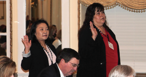 New Cotton Board members, Akiko Inui, left, importer alternate, and Ava Alcaida, board adviser, are sworn in at the March meeting.