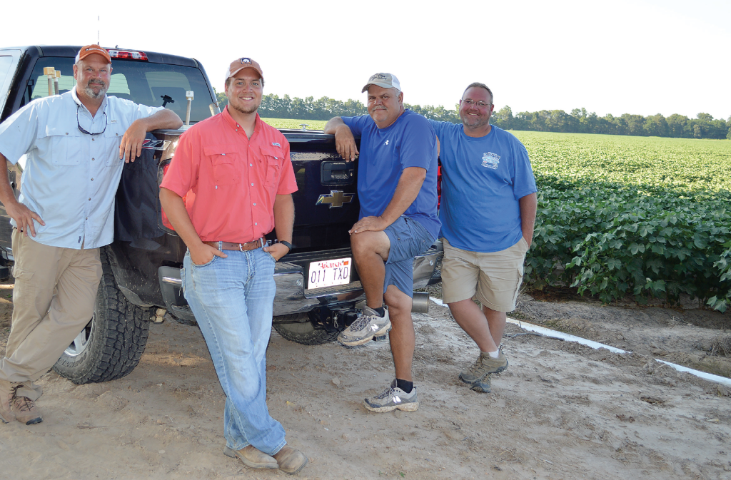 Matt Miles (left), Layne Miles, farm manager Billy Garner and crop consultant Robb Dedman say communication is key to maintain efficiency and profitability.