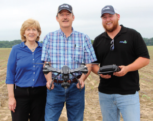 Best Yielder Club grand-prize winner William Dunlow, right, shares his excitement to win the unmanned aerial vehicle (UAV) with his father, David, and PhytoGen sales