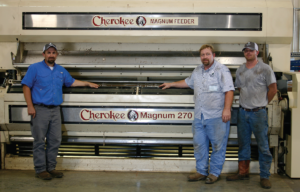 Aaron Litwiller (left); ginner Doug Dahlem; and his son Hunter, a fourth- generation ginner, prepare to crank up Bogue Chitto Gin for the upcoming season