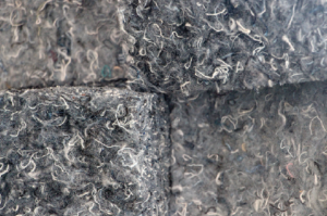 Recycled denim fibers can clearly be seen in this close-up photo of home and building insulation.