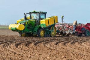 texas tractor plowing field